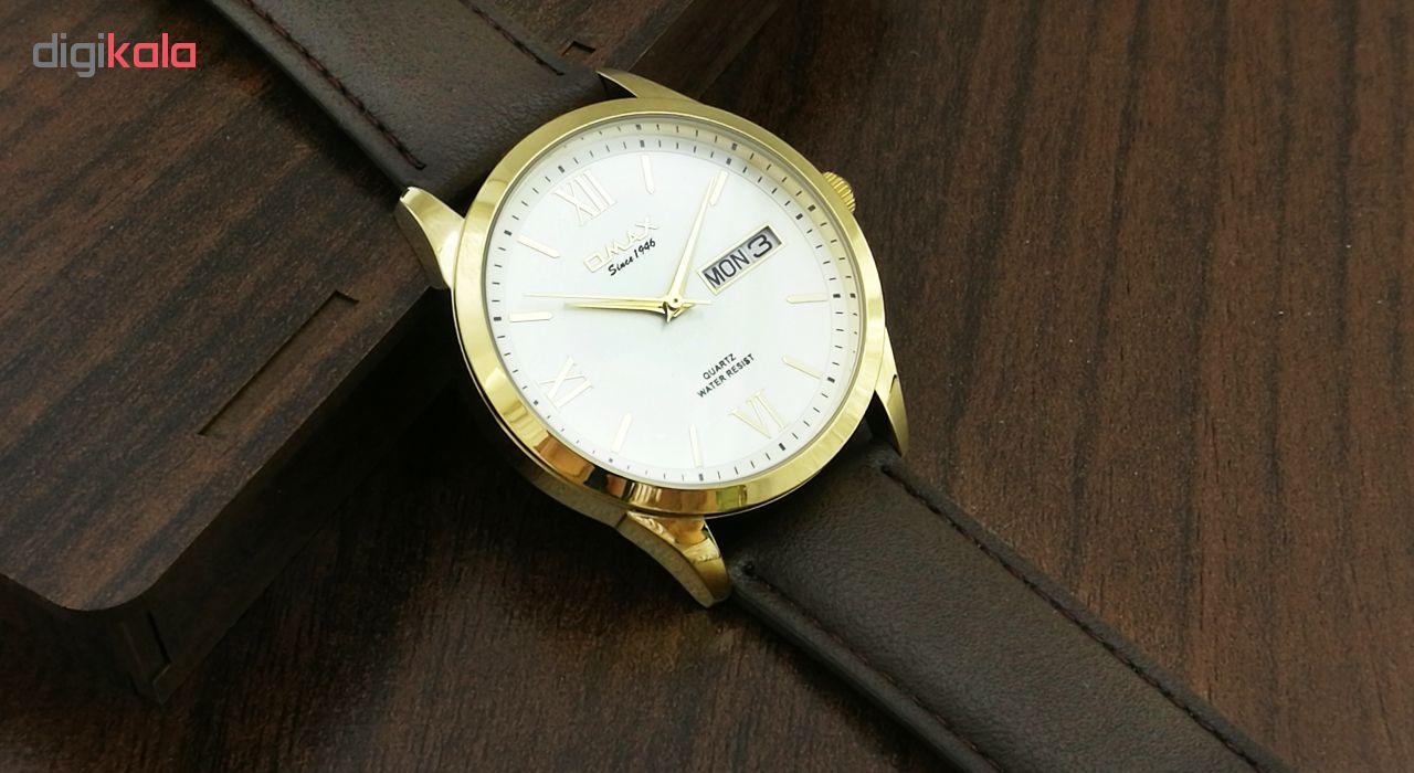 ساعت مچی عقربه ای مردانه اوماکس مدلgd05g35 به همراه دستمال مخصوص برند کلین واچ